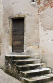 Weathered stone staircase to antique wooden front door — Stock Photo