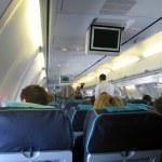 Passengers inside airplane — Stock Photo