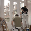 House painters at work - Stock Photo