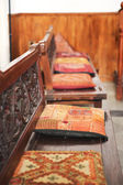 Wooden benches with cushions in synagogue — Stock Photo