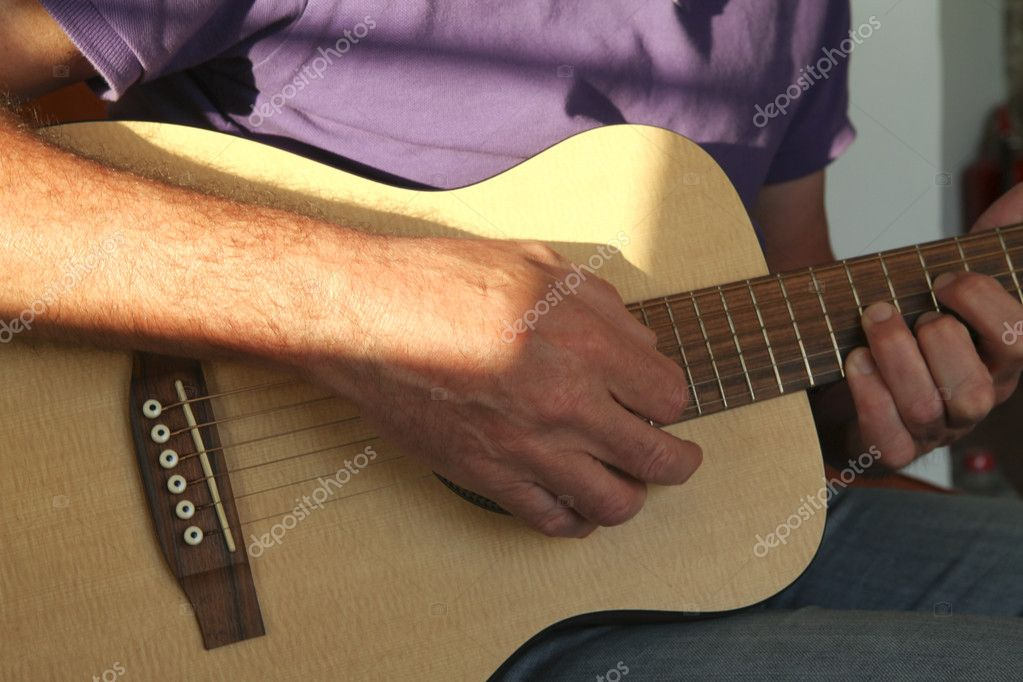 Man playing travel guitar — Stock Photo #9285485