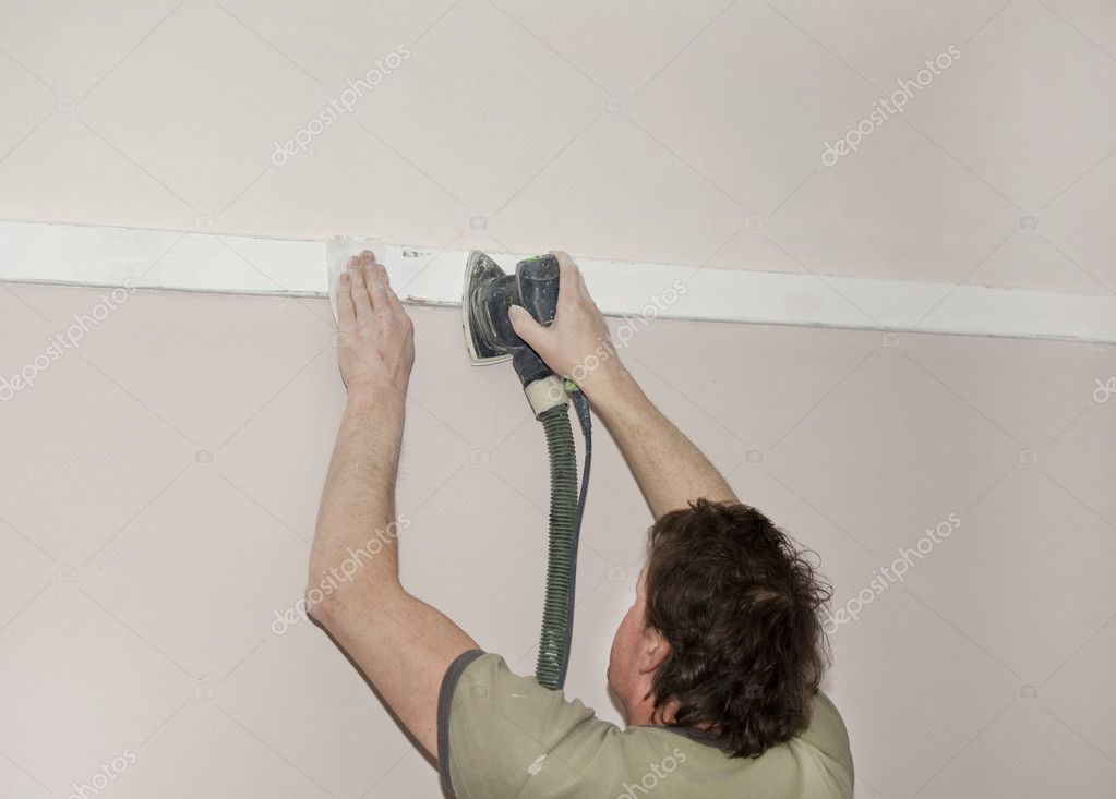 Painter sanding wooden beam — Stock Photo #9375527