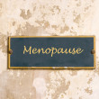 Menopause on weathered wall — Stock Photo