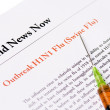 Stock Photo: Outbreak Swine Flu newspaper headline with syringe