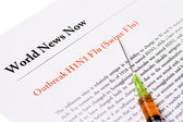 Outbreak Swine Flu newspaper headline with syringe — Stock Photo