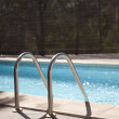 Swimming pool in sun — Stock Photo #9781648