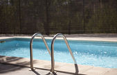Swimming pool in the sun — Foto Stock
