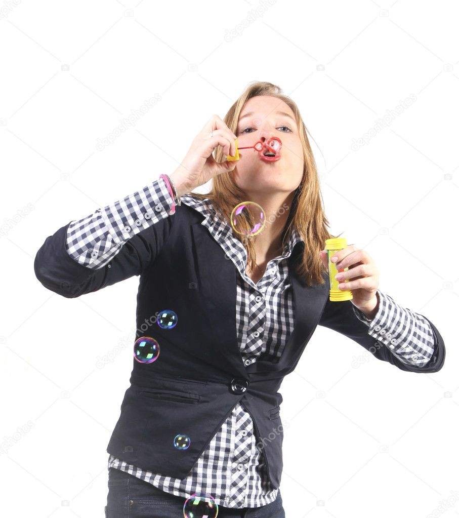 Young woman blowing bubbles — Stock Photo #9974815