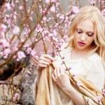 Girl in blossom garden — Stock Photo #10041623