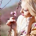 Girl in blossom garden — Stock Photo #10041639
