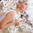 Girl in blossom garden — Stock Photo #10041642