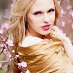 Girl in blossom garden — Stock Photo #10042003