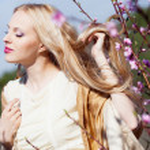 Girl in blossom garden — Stock Photo #10042025