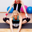 Stock Photo: Two girls stretching in club
