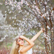 Girl in blossom garden — Stock Photo