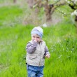 Child in garden — Stock Photo