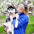 Woman with puppy husky — Stock Photo #10209996