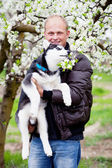 Man with puppy husky — Stock Photo