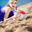 Girl with seashells on the beach — Stock Photo