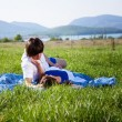 Two lovers on the grass — Stock Photo