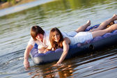 Two on swimming mattress — Stock Photo
