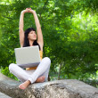 Stock Photo: Girl with laptop in the park