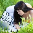 Girl with laptop in the park — Stock Photo