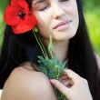 Girl with poppy flower — Stock Photo #10539757