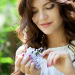 Girl with lilac flower — Stock Photo #10540046
