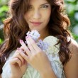 Girl with lilac flower — Stock Photo