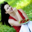 Girl with straberry in garden — Stock Photo