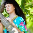 Beautiful girl near the tree — Stock Photo #10668498