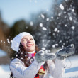 Girl playing with snow -  