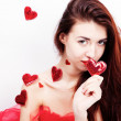 Brunette girl with red hearts - Stock Photo