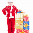 Stock Photo: Boy in christmas clothes with presents