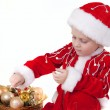 Stock Photo: Boy in christmas clothes with toys