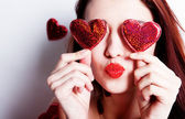 Brunette girl with red hearts — Stock Photo