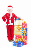 Boy in christmas clothes with presents — Stock Photo