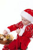 Junge im weihnachten kleidung mit spielzeug — Stockfoto