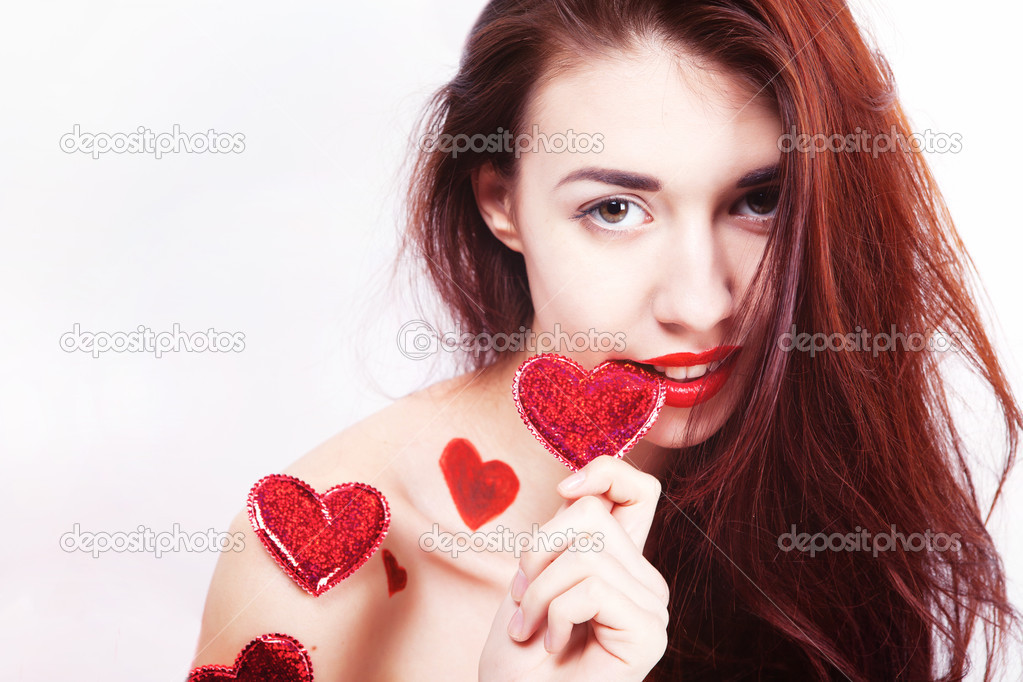 Brunette girl with red hearts isolated on white — Stock Photo #8831213
