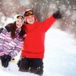 Girl and boy in winter park — Foto Stock