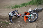 Falling motocross racer — Stock Photo