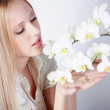 Girl with white orchid — Stock Photo