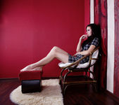Girl in red room — Stock Photo