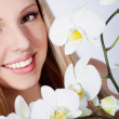 Girl with orchid — Stock Photo