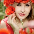 Girl in poppy wreath — Stock Photo
