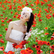 Beautiful girl in poppies — Stock Photo