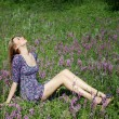 Girl on flower meadow - Stockfoto