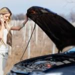 Girl with broken car — Stock Photo