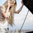 Girl with broken car - Stock Photo